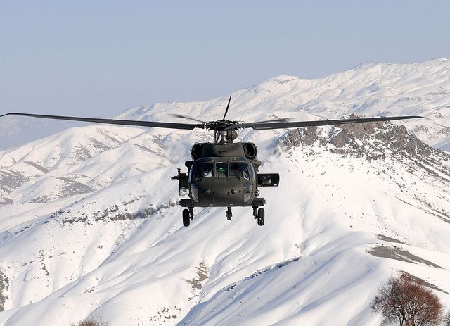 Chief Warrant Officer 2 Kevin Nolan, pilot in command with Task Force Talon and Chief Warrant Officer 2 John Booth fly a UH-60 Black Hawk near the snow covered mountains in Regional Command East, Parwan province area south of Bagram Airfield for a reenlistment ceremony.  #ArmyAviation: Forget Flying, Uh60 Black, Military Planes,  Snowplough, Black Hawks, Uh 60 Black, Snow Covers, Photos Shared, Covers Mountain