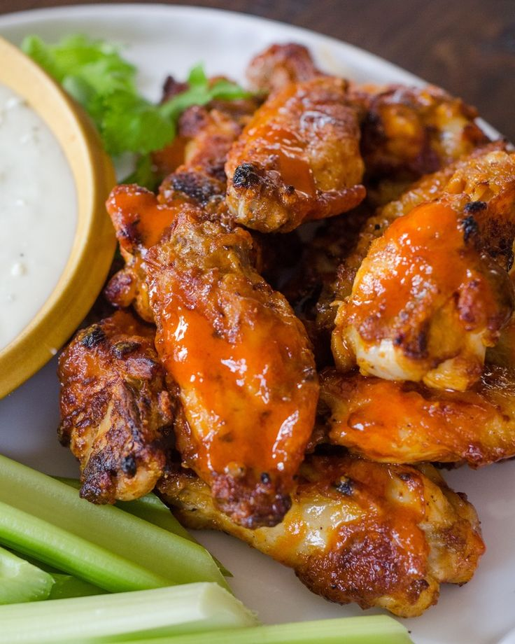 The last thing I want to do if there's a party happening and a major game on the television is man the deep-fryer back in the kitchen. But you can't have a Game Day party without buffalo chicken wings on the buffet table — inconceivable. The solution, obviously, is to turn to the next best thing: the oven. Doused in a double dose of hot sauce — first to marinate and then to coat — these oven-baked wings are arguably just as crispy, just as sticky, and just as addictive as their deep-f...