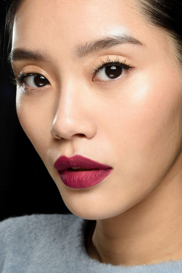 NYFW Fall 2015   Carolina Herrera: Dewy lashes and red lips made up Diane Kendal's irresistible makeup look for Carolina Herrera's fall show. That perfect, precise, matte shade was achieved using MAC's forthcoming Retro Matte Lip Lacquer (out next season!) in Oh, Lady.   refinery29