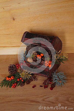 Christmas arrangement with berries and fir cones  on wood background