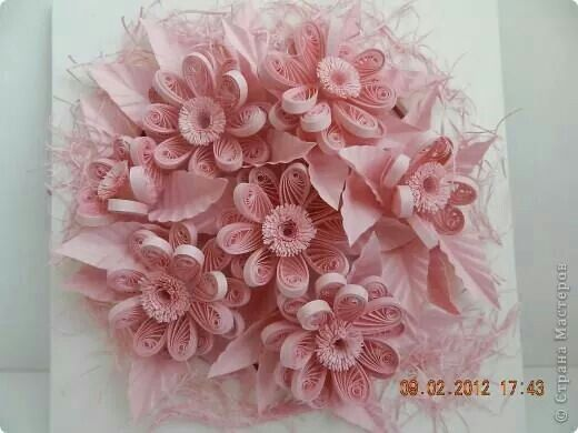 Pink flowers over a paper doiley