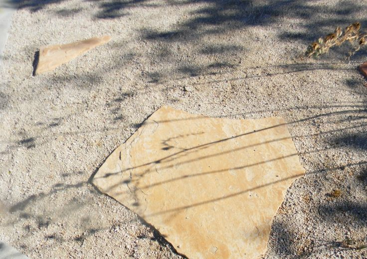 "Tan Decomposed Granite used with Buff Arizona Flagstone for a casual pathway. For best results install D. G. to 3 inches deep and use Arizona Flagstone that is at least 2"" thick. Set the stone on least 1"" base of compacted decomposed granite. Try to stay with Select or Stand-up grade stone. Better to spend the few extra dollars for stable and durable large pieces of stone.....http://www.earthstonerock.com/Arizona-Buff-Flagstone-Prices-s/276.htm"