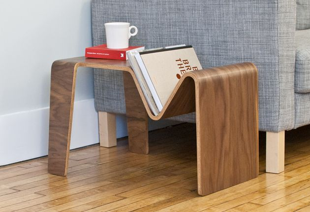 awesome.. Gotta check out this furniture line!  This piece is called Tre.  You could use it as an end table with a mag/book rack, or  you could flip it to use as a little lap top table or maybe a stool.. not sure if it could hold someone...  look into it.
