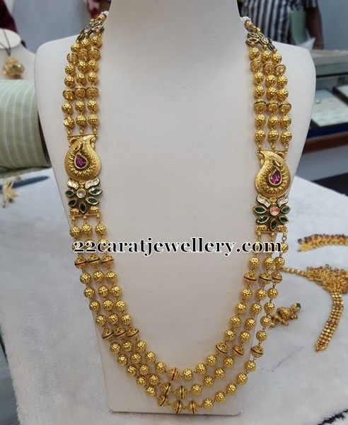 Jewellery Designs: Gold Beads Chain with Side Motifs