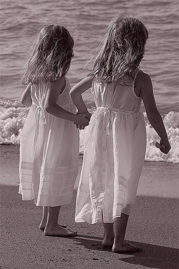 Sisters - reminds me of my two girls at the beach when they were little- about the same age span.  :)