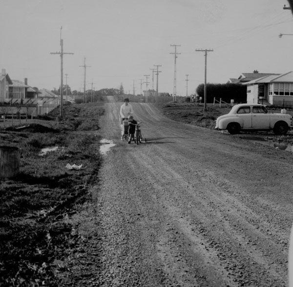 Woman with a pram, Flat Bush Road, Otara, 1966.