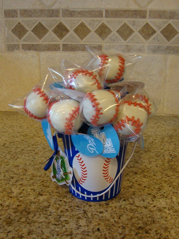 Baseball Cake Pops by SinfullySweet LA on Etsy. Can be customized with your favorite teams information or even a child's name. I love this little bucket they used to display the pops!