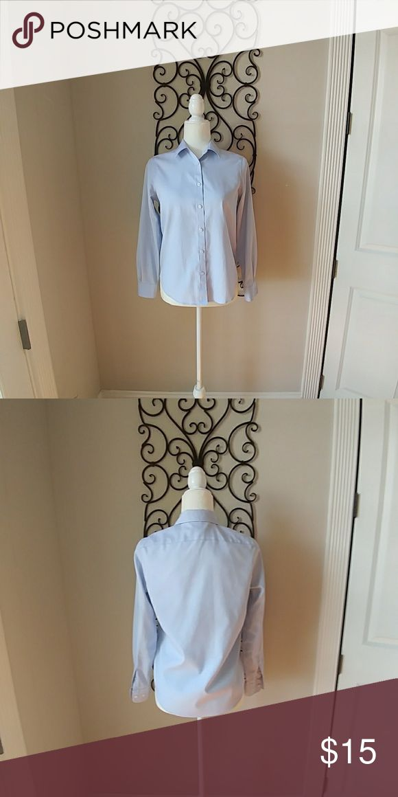 Jones New York Non Iron Shirt Light blue non iron button up in EUC. Its a great shirt to throw on with khakis or jeans with loafers. I loved this but its too snug for me now. Jones New York Tops Button Down Shirts