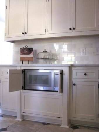 lower?!?! not sure if I like that? would give more room for food though?? Built-in microwave cabinet - Hidden Microwave