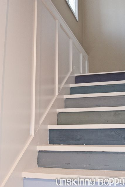 Multicolored Basement Staircase painting from a pinterest inspired photo. Also luv the board& batten paneling