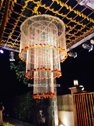 Such pretty traditional string floral hangings yellow and white <3 <3 #indianwedding #decor #idea #mehendi | Photo source: eventfully yours | curated by Witty Vows - The ultimate guide for the Indian Bride | www.wittyvows.com