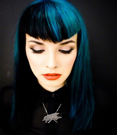 Blue hair color with hairstyle with bang