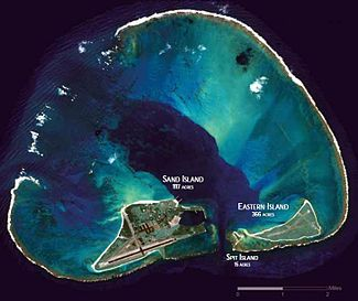 Midway Atoll-- (called Midway Island and Midway Islands; Hawaiian: Pihemanu Kauihelani) is a 2.4-square-mile (6.2 km2) atoll in the N Pacific Ocean at 28°12′N 177°21′WCoordinates: 28°12′N 177°21′W. As its name suggests, Midway is roughly equidistant between N America & Asia, & lies almost halfway around the world longitudinally from Greenwich, UK. It is near the northwestern end of the Hawaiian archipelago, about one-third of the way from Honolulu, Hawaii, to Tokyo, Japan