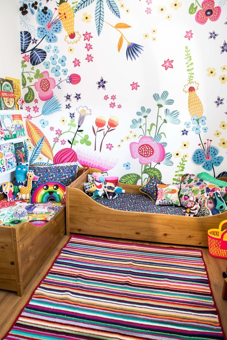 This bright and colorful kids room. Check out all the cute individual pillows.