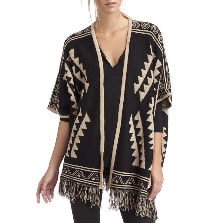 Fun print on this black and beige cardigan. Perfect for layering on colder days too.