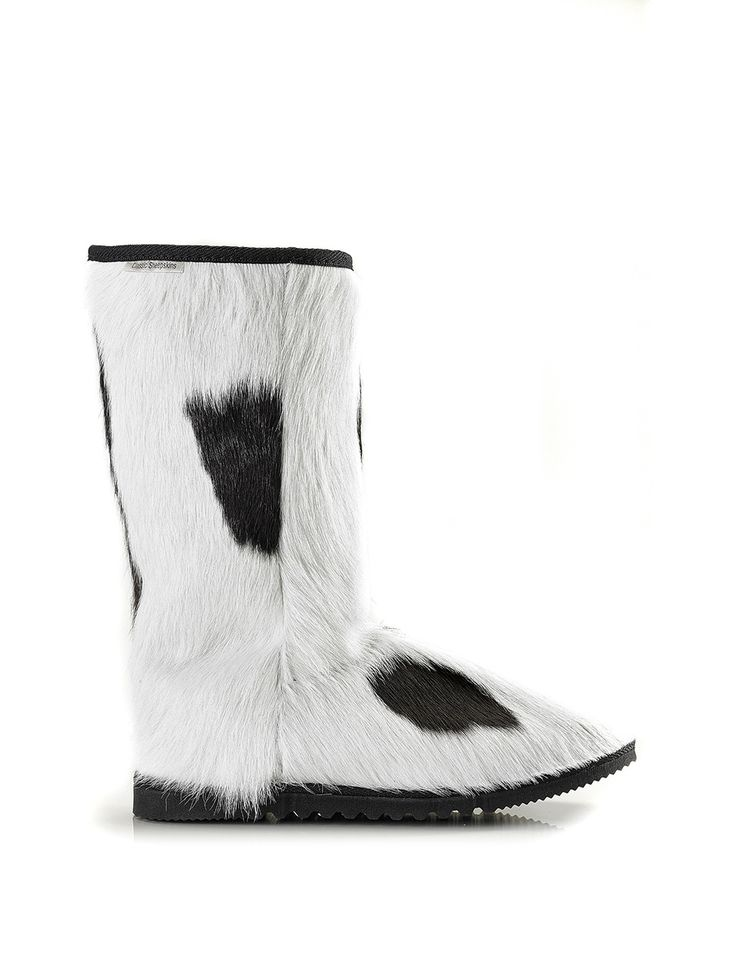 Moo Boots are totally unique made from calf skin no 2 pairs are the same making them extra special.  (http://www.classicsheepskins.com/moo-boot-white-and-black/)
