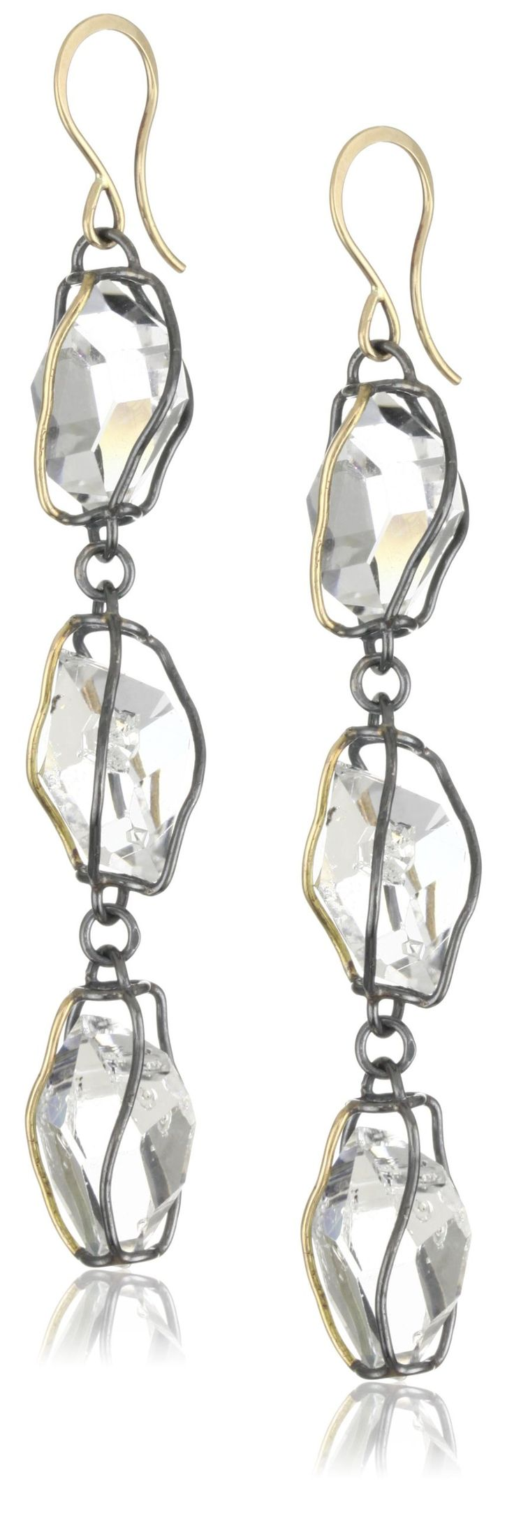 """Melissa Joy Manning """"New Elements"""" Caged Herkimer Imitation Diamond Earrings. 14k yellow gold and oxidized sterling silver three drop cage earrings with Herkimer imitation diamonds. Handmade in the artist's certified """"green"""" studio in California, each piece is crafted from 100% recycled metal. Herkimer imitation diamonds are found in one mine in Herkimer, New York. A natural crystal with a double matrix formation, it refracts light similar to a diamond- hence, the name. Herkimer imitation..."""