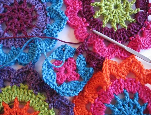Japanese flowers and a little granny square in the space between the flowers