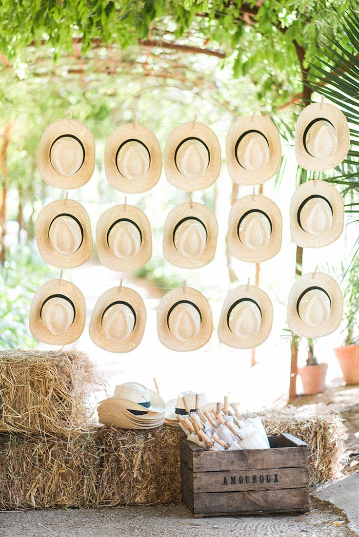 straw hat wedding favor ideas - photo by Adriana Morais http://ruffledblog.com/two-day-destination-wedding-celebration-in-portugal