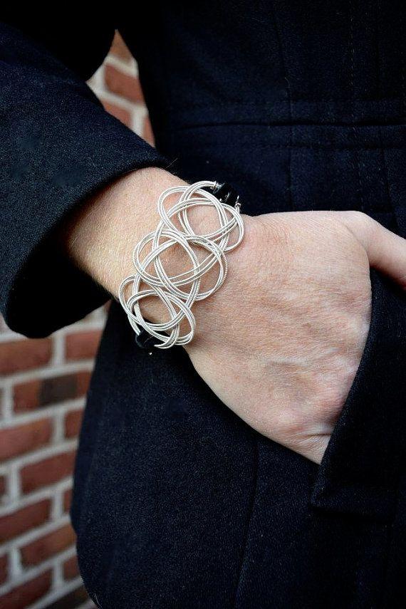 Gitarren String - Guitar String Schmuck - Keltische Knoten - keltische Knot Armband - Wildleder Schnur Armband                                                                                                                                                      Mehr