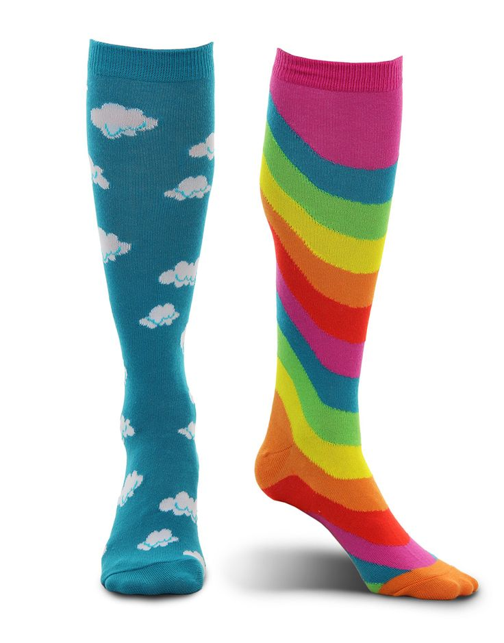 Bring happiness and color every where you go without getting cold feet wearing the elope Knee-High Rainbow Socks! These mismatched socks feature one sock that is blue with white clouds and one sock th