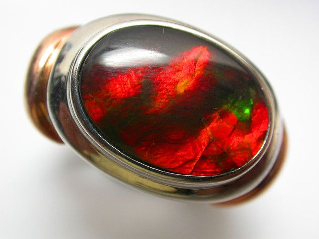 BRIGHT AMMOLITE RING SIZE 7 [SJ 2459]  AMMOLITE RING  This is a beautiful stone  from  Canada that  has been set in silver and is ready to wear.The stone is a triplet as it has a crystal top on the face of it which pervents scratchs.Stunning red flash-great ring!!