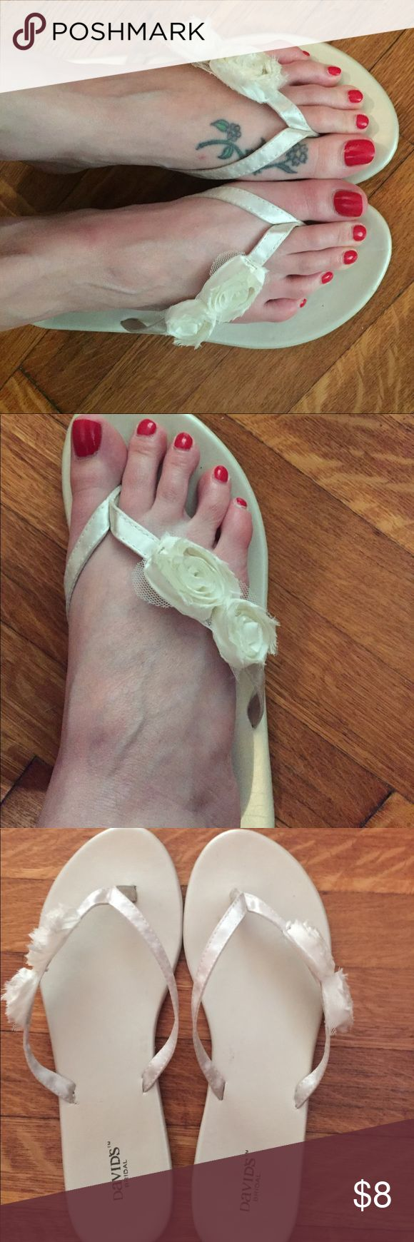David's Bridal Wedding Flip Flops. Sz M  (7-8) Cute David's Bridal wedding flip flops. Size medium. Ivory. Worn once for maybe an hour (indoor only)  at my reception in November. Very comfy & easy to dance in! David's Bridal Shoes Sandals