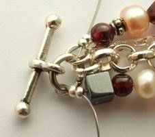 Learn how to make a multi strand bracelet with free step-by-step, illustrated instructions.