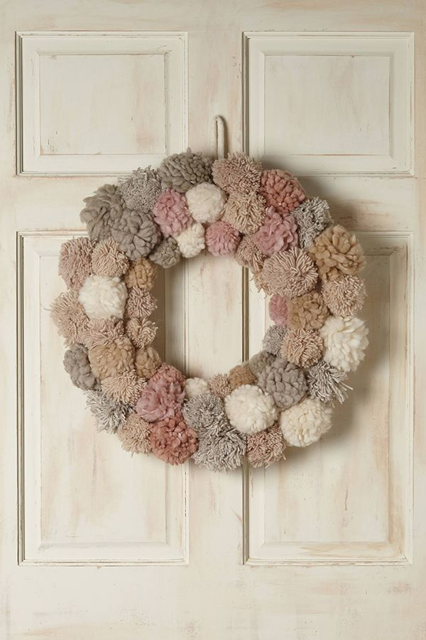 Pom-pon wreath - Christmas at Anthropologie - 2014  I made one of these a couple years ago using cream color yarn, but I love the look of this wreath using varied colored and textured yarns.