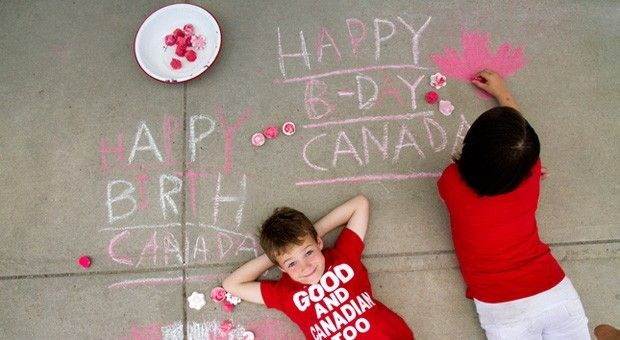 Kids draw with red and white sidewalk chalk.
