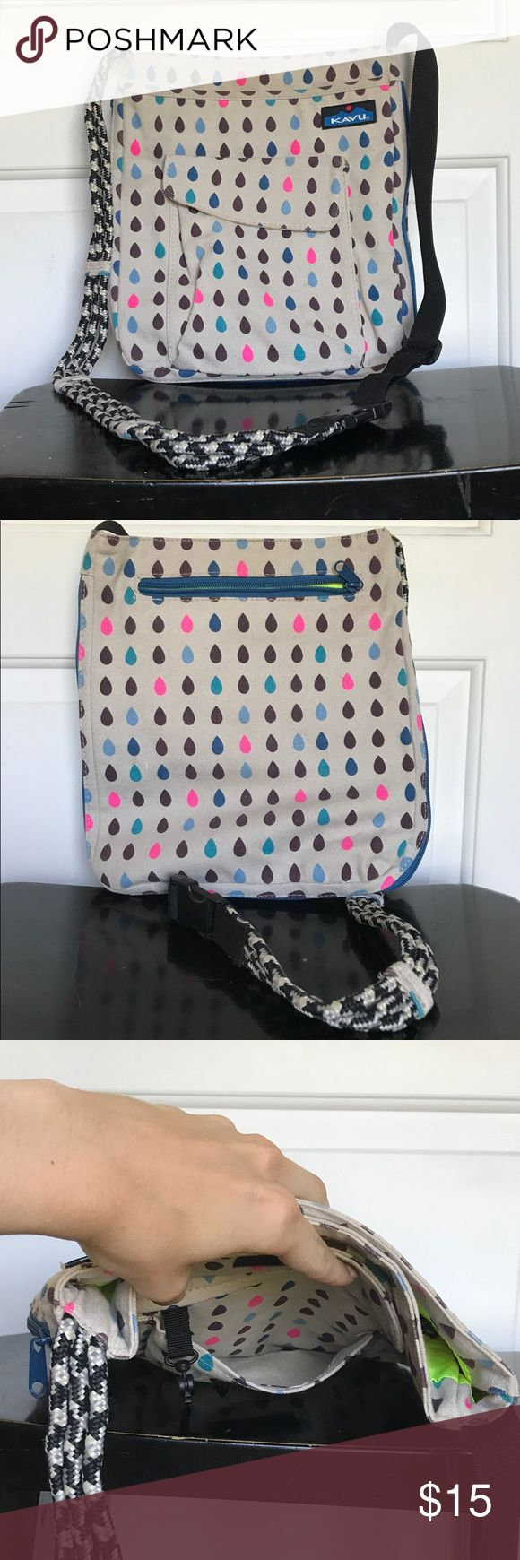 Kavu Crossbody Bag, Grey, Blue, Pink, Black This Crossbody bag features an open exterior pocket with a flap closure with a hook inside, a zipper exterior pocket on the back, and a zipper interior pocket. It's in excellent condition despite the pen ink stain in the bottom, which is invisible when worn. KAVU Bags Crossbody Bags