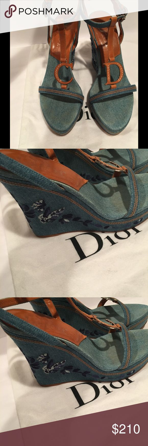 """Christian Dior Denim & Tan Embroidered Wedge 39.5 💯authentic Christian DIOR Denim and Leather Trim Embroidered 5"""" high Wedge. This show wraps around your ankles and has the classic C and D letters on each shoe ! Open toe ! size 39.5 , beautiful embroidery on wedge heel . Perfect when worn with dresses, skirts and even Jeans !! Super cute !! Christian Dior Shoes Wedges"""
