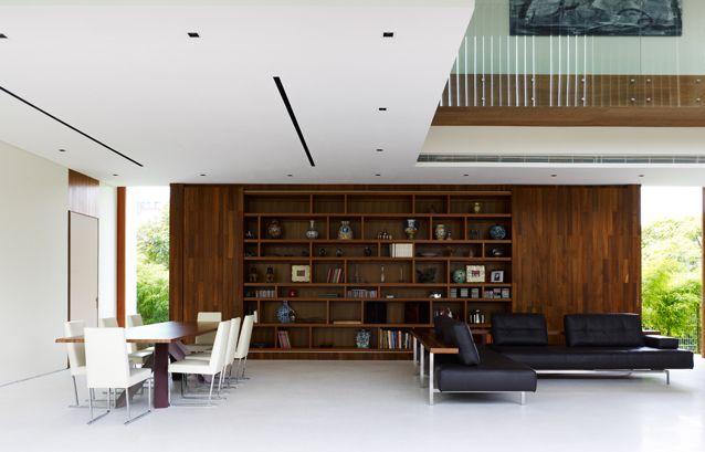 Wooden bookshelves. Scandinavian minimalist architecture.