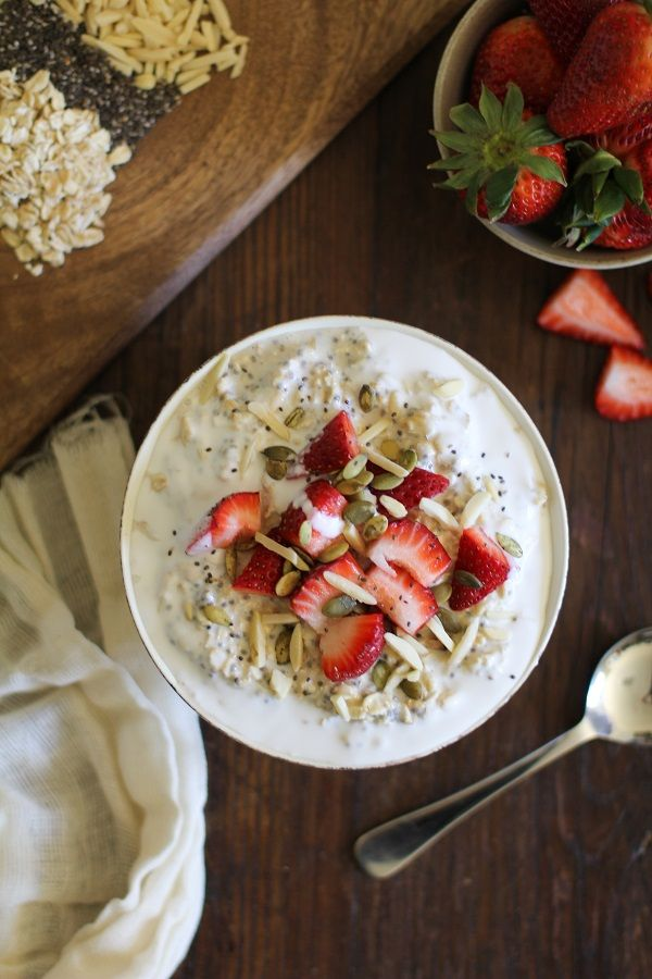 These filling Strawberry Oatmeal Breakfast Bowls include chia seeds, slivered almonds, coconut milk, and they're naturally sweetened with maple syrup.