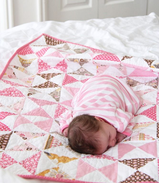 Free Baby Quilt Tutorial: A Pink Classic @ Cluck Cluck Sew: After staring at fabrics for too long trying to decide what pattern to make my baby a quilt with…I went with classic hourglass blocks. There are probably loads of good tutorials for these blocks already, but since these are one of my favorites I wrote one up for this quilt...