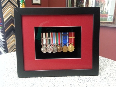 Hinged medal box. Opens to take the medals out with a hinged front. Member of 1 Combat Engineer Regiment, Canadian Army.