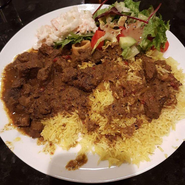 love me some curry goatseasoned rice coleslaw salad