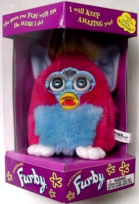 generation 5 -- Sherbert Furby << I remember Christmas 1999. My two favorite Christmas presents were the Prince of Egypt on VHS and this Furby. My sister and I each got a Furby and we would get them to dance together. They lasted through high school but they ended up buried for years. One of them broke. The other one WENT OFF RANDOMLY - NO ONE HAD TOUCHED IT - EVEN AFTER BEING BURIED FOR YEARS. IT JUST TALKED. Oh, and they can ABSOLUTELY talk without batteries! Creepiest thing ever.