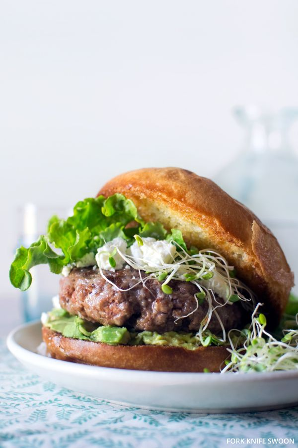 Lamb Burgers with Goat Cheese and Avocado | 1 lb ground lamb, 4 brioche or whole-wheat buns, 4 tbsp goat cheese, crumbled, 1 avocado, pitted and sliced, 1 tsp curry powder, 1 tsp paprika, 1 tsp kosher salt, 1/2 tsp freshly-ground black pepper. Optional Toppings: lettuce, fresh sprouts, slices of red onion, cucumber slices