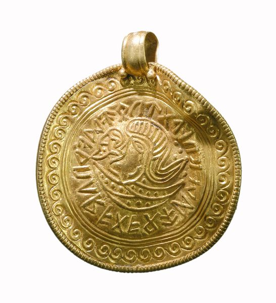 Gold bracteate with runes. The runic inscription does not form a reasonable sentence. Dated to Late Scandinavian Iron Age (AD 400-1050).