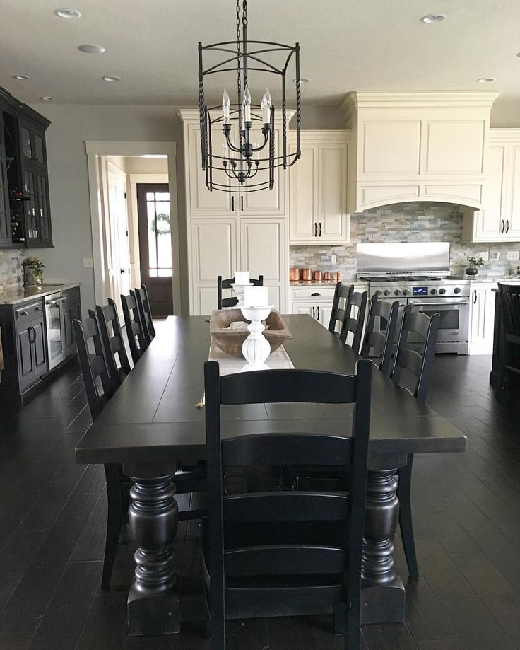 Black and white modern farmhouse kitchen with long dining table | See this Instagram photo by @farmhouseredefined