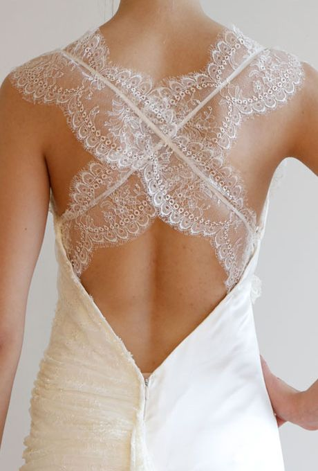 """Brides.com: Spring 2014 Wedding Dress Trends. Trend: Crisscross Backs. Inspired by the open-back trend from Fall 2013, designers added a touch of drama for Spring 2014 in the shape of an """"X."""" Graphic, bold and undeniably elegant (especially when done in Chantilly lace or accented with crystals), an open back is extremely sexy. Says Leonard, """"it's also a great alternative to a strapless wedding dress."""""""