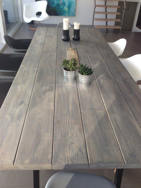 Wooden table in grey rustic colour. Plankebord