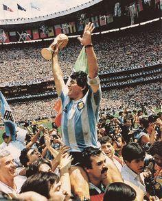 Diego Maradona, Football Legend, holding aloft the 1986 World Cup trophy.