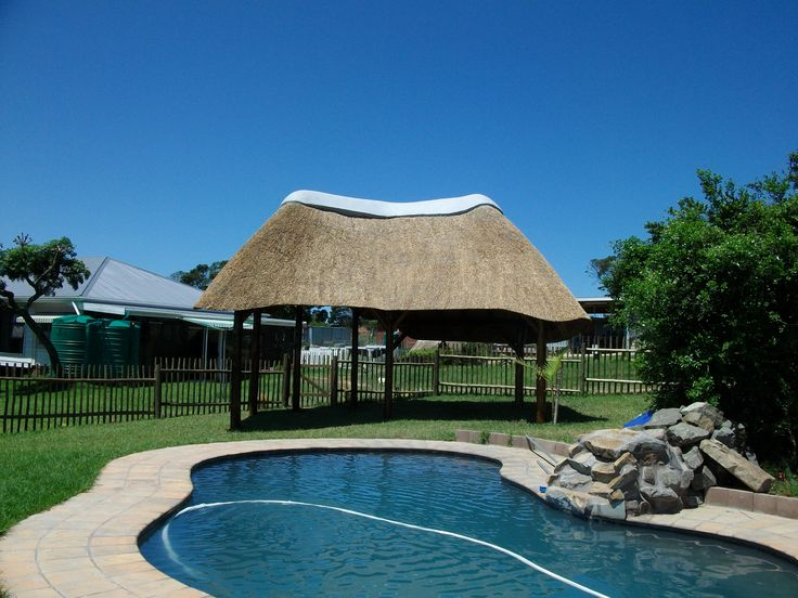 Love the curved shape of this small lapa by the pool where shade was a problem before the lapa was installed