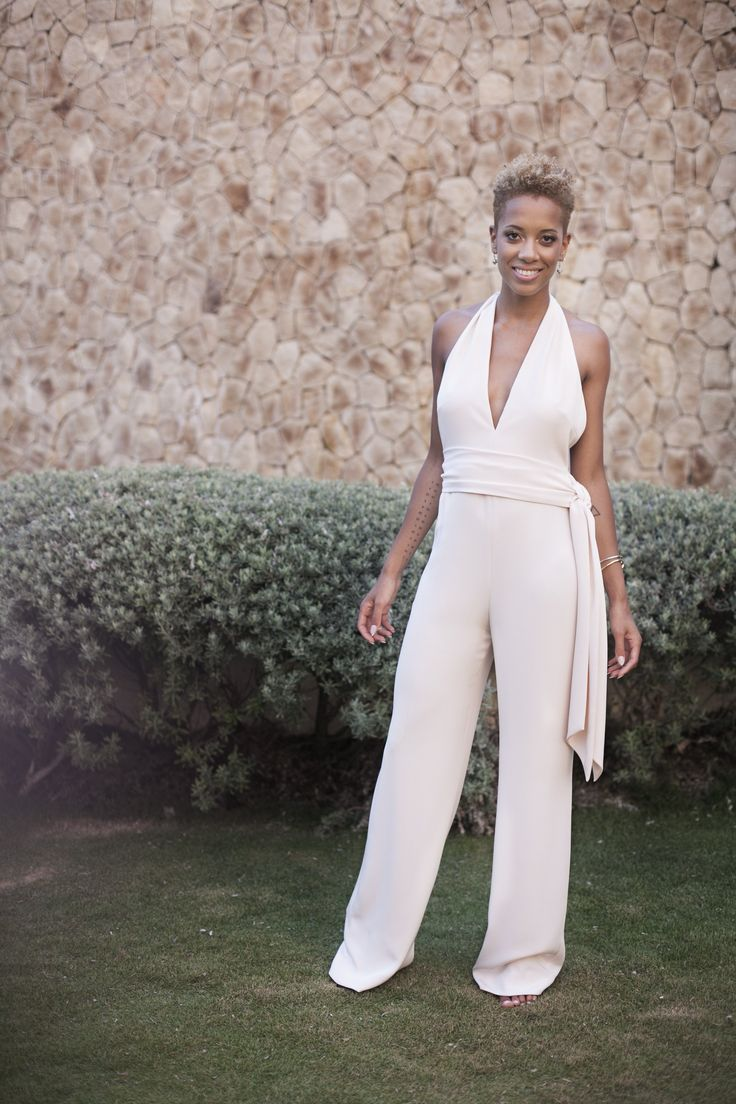 We opted for a jumpsuit for Carly's maid of honor attire. It was unexpected and felt more like the overall laid-back vibe we were going for.
