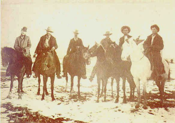 Extremely rare photo of Billy when captured at Stinking Springs, December 24th 1880.  Pat Garrett is clearly recognisable extreme left and Bob Olinger is next to him.   Billy is on the extreme right where a deputy aims a Colt revolver at Billy's head.  One of Billy's compadres, Charlie Bowdre, had been killed in the encounter.