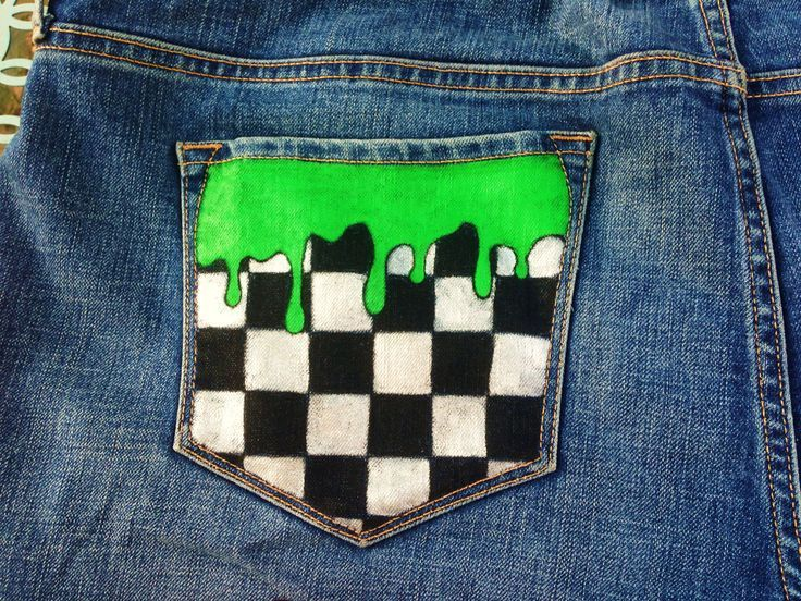 Black and white checkered with green slime on the back pocket of the jeans.