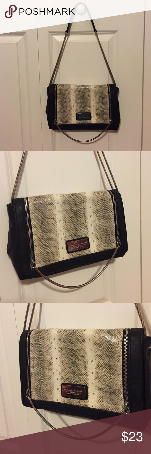 Armani Exchange purse Fashionable black and snakeskin (white) bag. Zipper aligning through front. Never worn but no tag. Armani Exchange Bags Shoulder Bags