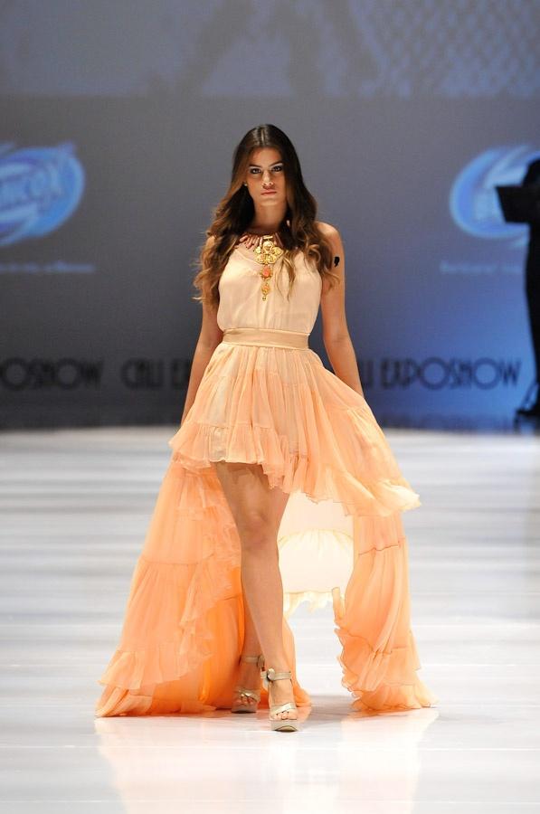 Renata lozano, peach dresswith Tail hem skirt